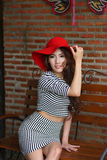 Beautiful young woman posing alone at the outdoor cafe. Model is Thai Ethnicity Royalty Free Stock Photography