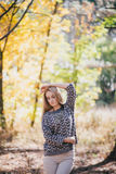 Beautiful young woman posing in an autumn forest Royalty Free Stock Photos
