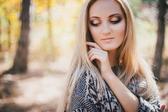 Beautiful young woman posing in an autumn forest Royalty Free Stock Photo