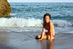 Beautiful young woman posing on the beach. Spain Stock Photos