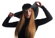 Beautiful young woman posing in black hat isolated on white stock photos