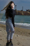 Beautiful young woman. Young woman posing on Black Sea shore in a spring day Royalty Free Stock Photos