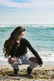 Beautiful young woman. Young woman posing on Black Sea shore in a spring day Royalty Free Stock Images