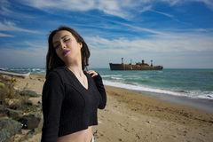 Beautiful young woman. Young woman posing on Black Sea shore in a spring day stock photography