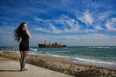 Beautiful young woman. Young woman posing on Black Sea shore in a spring day stock photo