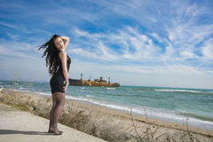 Beautiful young woman. Young woman posing on Black Sea shore in a spring day Stock Photos