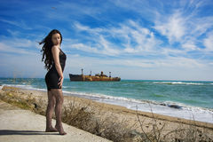 Beautiful young woman. Young woman posing on Black Sea shore in a spring day Royalty Free Stock Photography