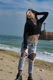 Beautiful young woman. Young woman posing on Black Sea shore in a spring day stock images