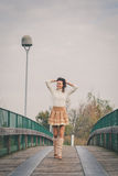 Beautiful young woman posing on a bridge Royalty Free Stock Photo