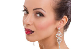 Beautiful young woman posing  with bright red lips and  jewelle Stock Photo