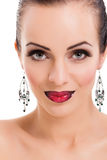 Beautiful young woman posing  with bright red lips and  jeweller Royalty Free Stock Photography