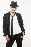 Beautiful young woman posing in business suit and hat. Royalty Free Stock Photo