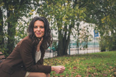 Beautiful young woman posing in a city park Royalty Free Stock Photography