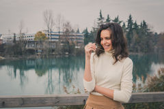 Beautiful young woman posing in a city park Royalty Free Stock Photos