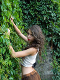 Beautiful young woman,posing in city of Sighisoara, Romania. Beautiful young woman,posing in city of Sighisoara, Romania, expressive, with green ivy at her back Royalty Free Stock Photos