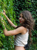 Beautiful young woman,posing in city of Sighisoara, Romania. Beautiful young woman,posing in city of Sighisoara, Romania, expressive, with green ivy at her back Stock Photo