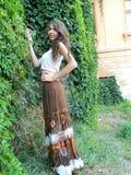 Beautiful young woman,posing in city of Sighisoara, Romania. Royalty Free Stock Photo