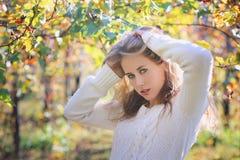 Beautiful young woman posing in colorful vineyard Stock Photos