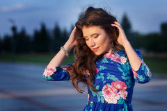 Beautiful young woman posing in evening summer park Stock Photo