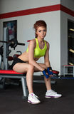 Beautiful young woman posing in fitness center Stock Image