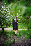 Beautiful young woman posing in a flowering spring park Royalty Free Stock Images