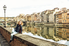 Beautiful young woman posing in front of amazing bridge Ponte Ve Royalty Free Stock Images