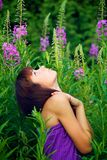 Beautiful young woman posing in green grass royalty free stock photo