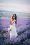 Beautiful young woman posing in a lavender field Royalty Free Stock Image