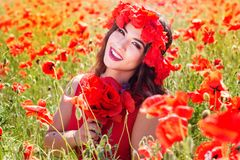 Beautiful young woman is posing near roses Royalty Free Stock Photo