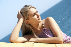 Beautiful young woman posing near sea Royalty Free Stock Photo