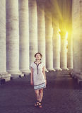 A beautiful young woman posing near St. Peter's square in Vatican, Rome Stock Photography