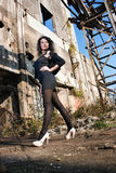 Young woman in old factory Royalty Free Stock Photography
