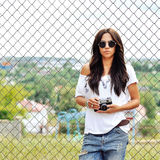 Beautiful young woman posing with old fashion camera Royalty Free Stock Photo