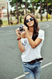 Beautiful young woman posing with old fashion camera Stock Photos
