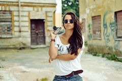Beautiful young woman posing with old fashion camera Stock Images