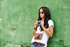 Beautiful young woman posing with old fashion camera.  Stock Image