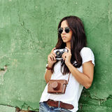 Beautiful young woman posing with old fashion camera Royalty Free Stock Images