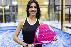 Beautiful young woman posing on paddle tennis court. Royalty Free Stock Image