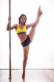 Beautiful young woman posing at pole Stock Photos