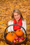 Beautiful young woman posing with pumpkin, apples Royalty Free Stock Image