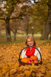 Beautiful young woman posing with pumpkin, apples Royalty Free Stock Photo