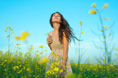 Beautiful young woman posing in the rapeseed field Royalty Free Stock Images