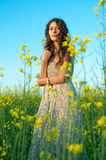 Beautiful young woman posing in the rapeseed field Royalty Free Stock Photo