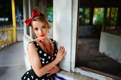 Beautiful young woman posing in retro dress royalty free stock photography