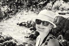 Beautiful young woman posing at the seashore, Solta, colorless Stock Photo