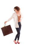 Beautiful young woman posing with shopping bags Stock Photo