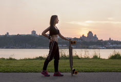 Beautiful young woman posing with a skateboard Royalty Free Stock Photo
