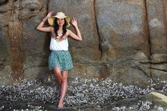 Beautiful young woman posing on stones near sea Royalty Free Stock Photos