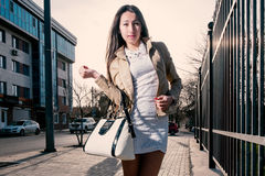 Beautiful young woman posing in a street over Royalty Free Stock Photos