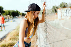 Beautiful young woman posing in the street. Royalty Free Stock Images